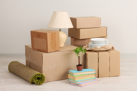 removals: Moving boxes on the floor in empty room
