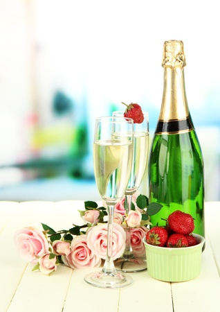 Romantic still life with champagne, strawberry and pink roses, on bright background Stock Photo - 20811508