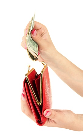 Female hand holding red purse, isolated on white photo
