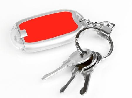 trinket: House keys and keychain isolated on white Stock Photo