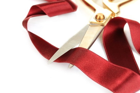 Satin ribbon curled around scissors isolated on white photo