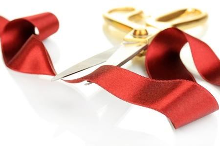Satin ribbon curled around scissors isolated on white photo