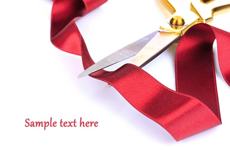 Satin ribbon curled around scissors isolated on white Stock Photo - 20812865