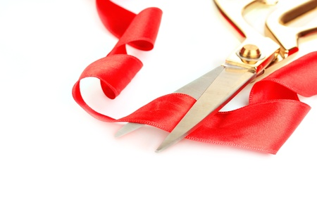 grand sale: Satin ribbon curled around scissors isolated on white