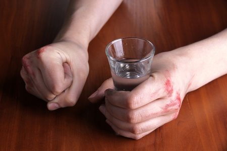Hand hold alcoholic drink close-up Stock Photo - 20962494