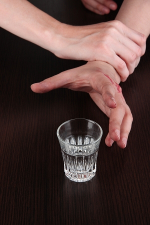 forlorn: Hand avoid alcoholic drink close-up