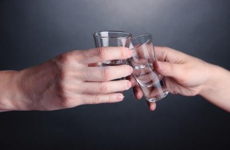Drunk mans hold vodka drinks close-up