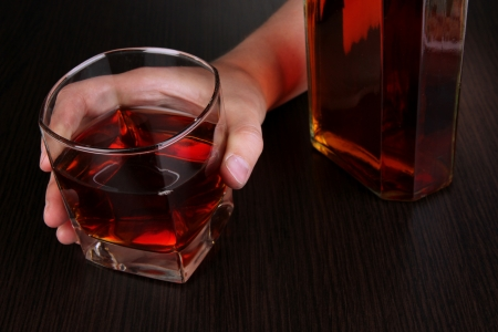 forlorn: Hand hold alcoholic drink close-up
