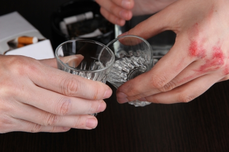 Hand hold alcoholic drink close-up photo