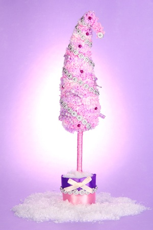 shimmery: Christmas tree with curved tip on lilac background Stock Photo