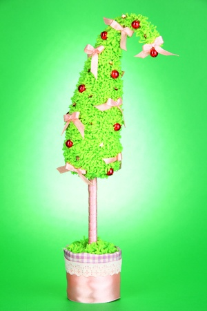 shimmery: Christmas tree with curved tip on green background