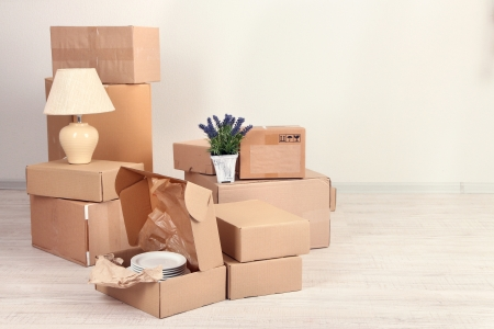 Moving boxes on the floor in empty room photo