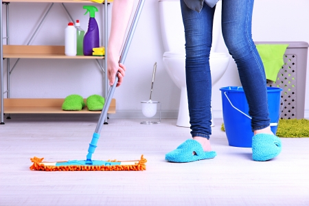 house chores: Cleaning floor in room close-up