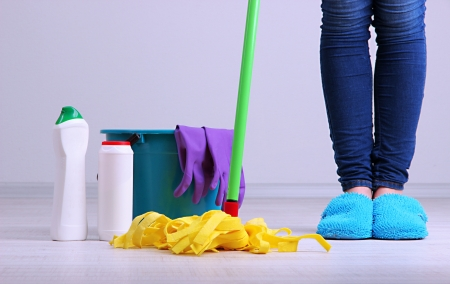 unkempt: Cleaning floor in room close-up