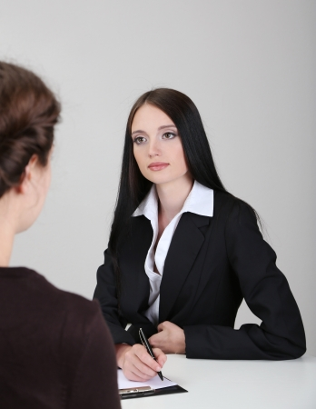 Recruiter checking candidate during job interview Stock Photo