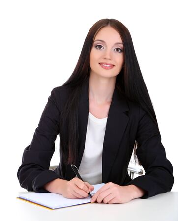 Young business woman writing, isolated on white Stock Photo - 21527880