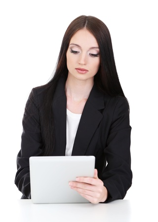Young business woman working with tablet, isolated on white Stock Photo - 21527905
