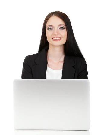 Young business woman working with computer, isolated on white Stock Photo - 21527914