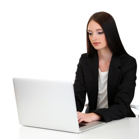 Young business woman working with computer, isolated on white photo