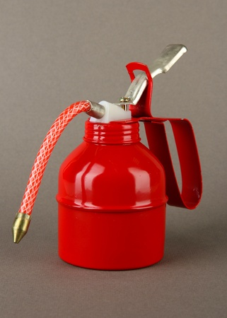 Red oil can, on color background Stock Photo - 20907675
