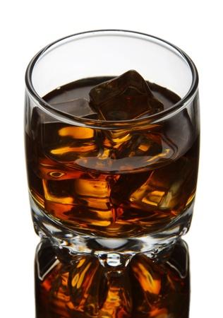 drunks: Brandy glass with ice on grey background
