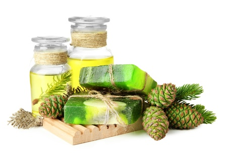 Hand-made soap and bottles of fir tree oil, isolated on white photo