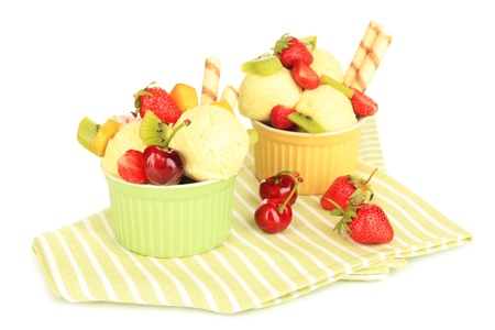 sweetie: Delicious  ice cream with fruits and berries in bowl isolated on white