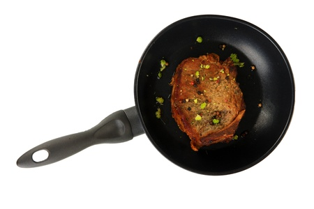 browned: Piece of fried meat on pan isolated on white