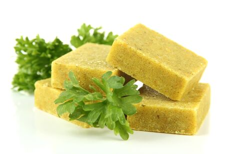 briquettes: Bouillon cubes with parsley, isolated on white Stock Photo