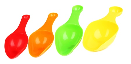 Empty measuring cups for washing powder isolated on white Stock Photo