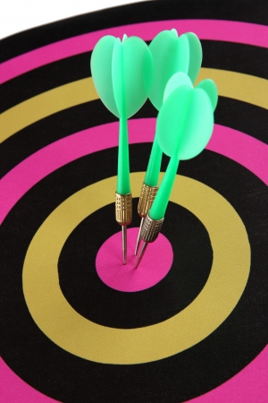 Target with darts close-up