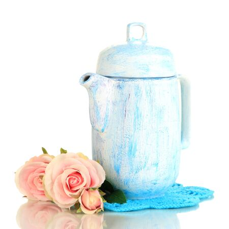 Antique white teapot isolated on white photo