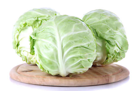 Cabbage on board for cutting isolated on white Stock Photo
