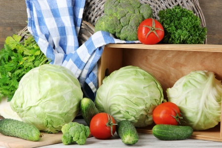 Composition of vegetables on table on wooden background photo