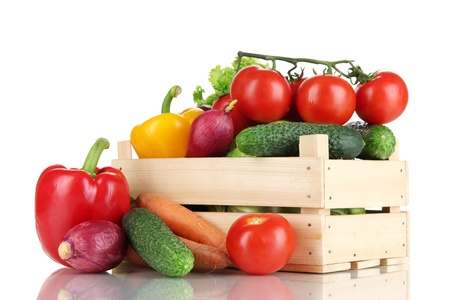 white  background: Fresh vegetables in wooden box on white background