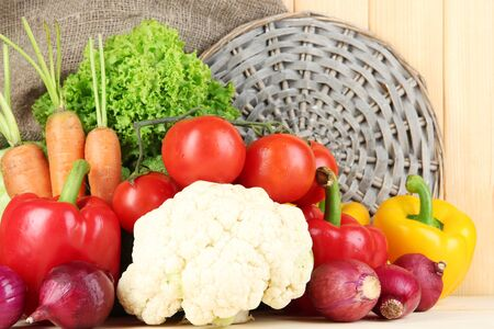 Fresh vegetables on wooden table close up photo