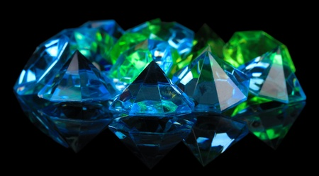 Diamonds on dark color background photo