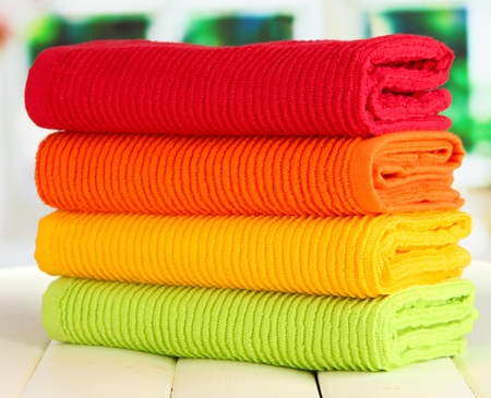 Colorful towels on wooden table on window background Stock Photo - 20967071