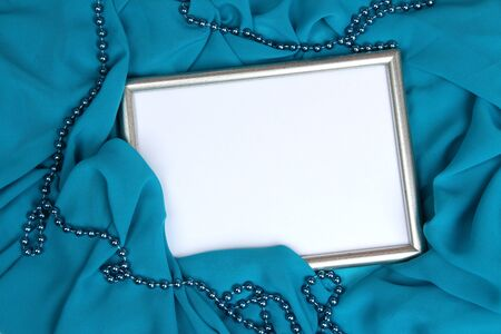 Empty frame on beautiful silk background photo