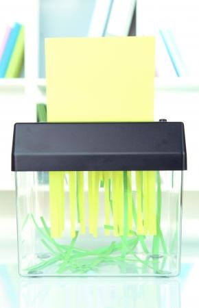 shredder machine: Paper shredder machine, on office interior background