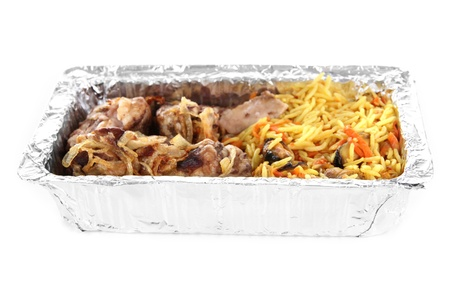Food in box of foil isolated in white photo