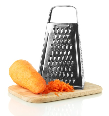 Metal grater and carrot on cutting board, isolated on white photo