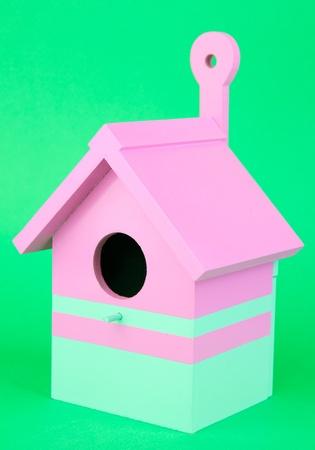 Decorative nesting box on color background photo