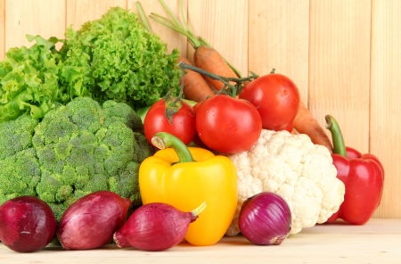 Fresh vegetables on wooden background photo