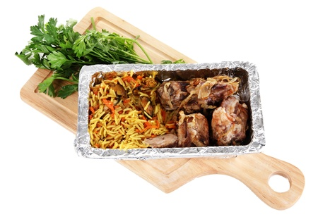 Food in box of foil on wooden board isolated in white photo
