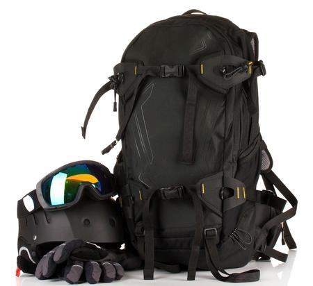 Winter sport glasses, helmet and gloves, backpack, isolated on white photo