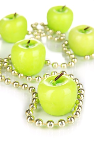 votive: Aroma apple candles with beads close up Stock Photo