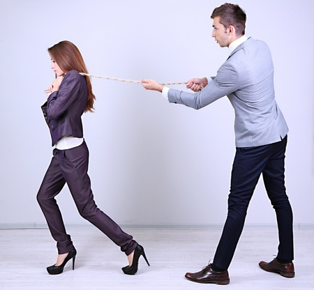 Business people stretching rope photo