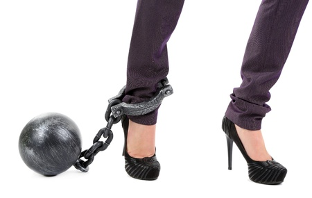 Business worker with ball and chain attached to foot isolated on white photo