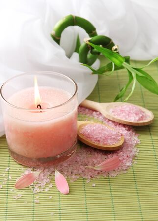 Beautiful candle on bamboo mat photo